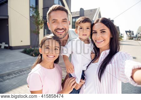 Self-portrait Of Nice Cheerful Lovely Family Embracing Mom Dad Carrying Son Spending Time Fresh Air