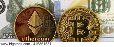 A One Hundred Dolloar Bill Is The Background For One Ethereum And One Bit Coin Gold Coins.