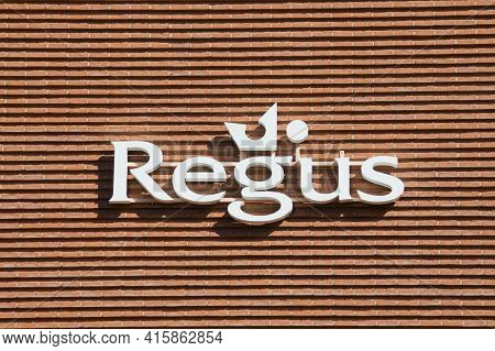 Lugano, Ticino, Switzerland - 16th March 2021 : White Regus Sign Hanging On The Office Building In L