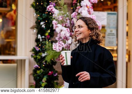 Beautiful Young Caucasian Woman Near Cafe, Door Decoration, Easter Bunnies, Spring Flowers, Warm Lig