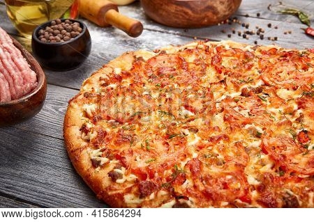 Real Delicious Appetizing Homemade Pizza With Minced Meat On A Gray Wooden Background.