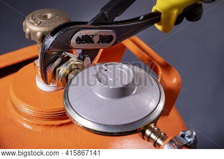 Installation Of The Reducer To The Gas Cylinder. Installation Work On The Gas Installation.