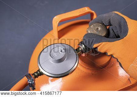 Unscrewing The Valve In The Propane-butane Gas Cylinder. Installation Work On The Gas Installation.
