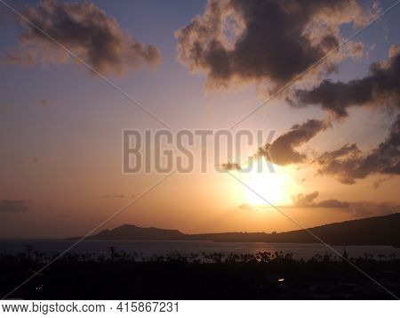 Sunset Over Hawaii Kai With Diamond Head Crater In The Distance On Oahu, Hawaii.