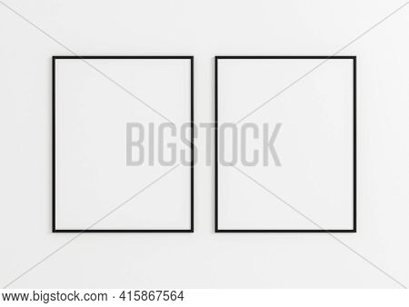 Double 8x10 Vertical Black Frame Mockup On White Wooden Wall. Two Empty Poster Frame Mockup On White