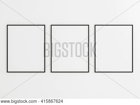 Triple 8x10 Vertical Black Frame Mockup On White Wooden Wall. Three Empty Poster Frame Mockup On Whi
