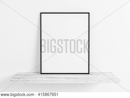 Single 8x10 Vertical Black Frame Mockup On Wooden Shelf And White Wooden Wall. One Empty Poster Fram