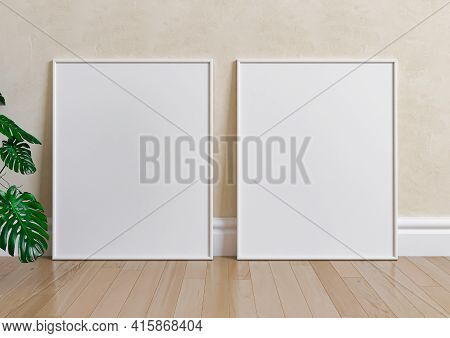 Double 8x10 Vertical White Frame Mockup On Wooden Floor And Beige Wall. Two Empty Poster Frame Mocku