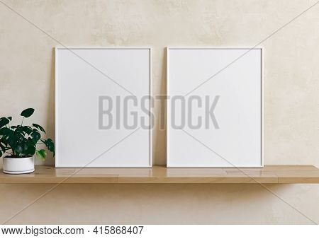 Double 8x10 Vertical White Frame Mockup With Plant In Vase On Wooden Shelf And Beige Wall. Two Empty