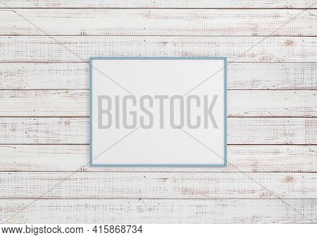 Single 8x10 Horizontal Blue Frame Mockup On White Wooden Wall. One Empty Poster Frame Mockup On Whit