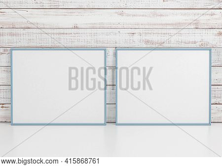 Double 8x10 Horizontal Blue Frame Mockup On White Floor And White Wooden Wall. Two Empty Poster Fram