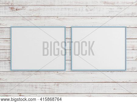 Double 8x10 Horizontal Blue Frame Mockup On White Wooden Wall. Two Empty Poster Frame Mockup On Whit