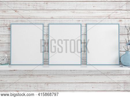 Triple 8x10 Vertical Blue Frame Mockup On White Shelf And White Wooden Wall. Three Empty Poster Fram