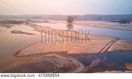 Sunrise Spring Melting River Flood Aerial Panorama. Overflow Water At Springtime. Rural April Landsc