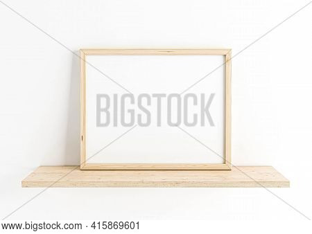 Single 8x10 Horizontal Wooden Frame Mockup On Wooden Shelf And White Wall. One Empty Poster Frame Mo