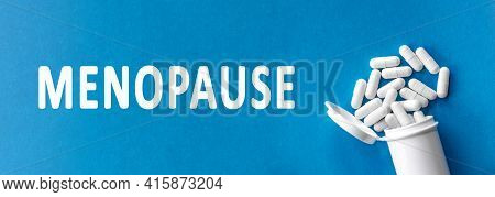 The Word Menopause Is Written Near Pills On A Light Blue Background. Medical, Health And Happiness C