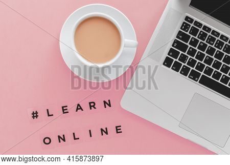 Laptop, Coffee Cup And Hashtag Inscription Learn Online On Pink Background, E Education Concept