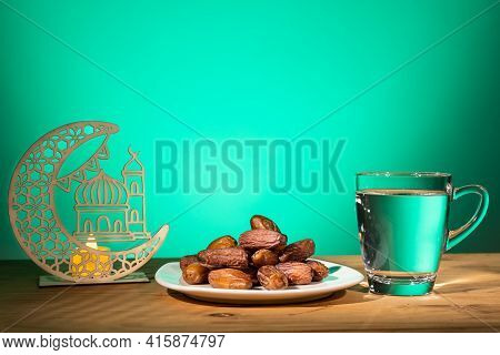 Muslim Iftar Of Breaking Of Fast During Ramadan Month With Preserved Sweet Dates And Water. Decorati