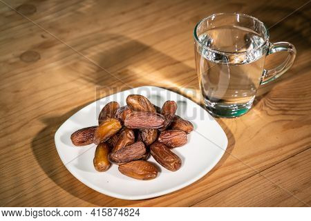 Muslim Iftar Of Breaking Of Fast During Ramadan Month With Preserved Sweet Dates And Water