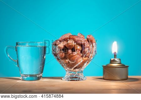 Muslim Iftar Of Breaking Of Fast Food During Ramadan Month With Preserved Sweet Dates And Water. Pel