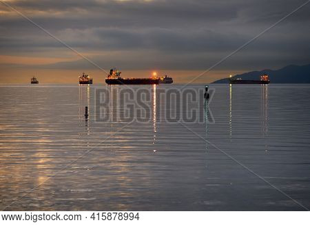 English Bay Freighters At Night. Freighters At Dusk In English Bay. British Columbia, Canada.