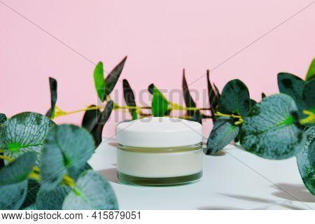 Moisturizing Cream Jar And Eucalyptus Leaves. Organic Moisturizer, Beauty Treatment Concept. Cosmeti