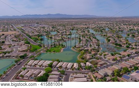 Aerial Overlooking Small Desert Small Town A Avondale City Of Rugged Mountains Near Of State Capital