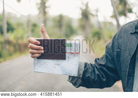Man With Backpack Hold Map Hand Sign
