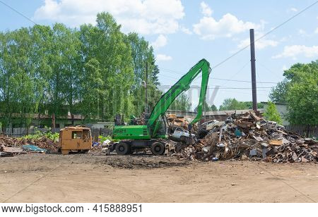 Russia July 28, 2020. Tver Region, Russia. A Wheeled Excavator Stands At A Scrap Metal Collection Po