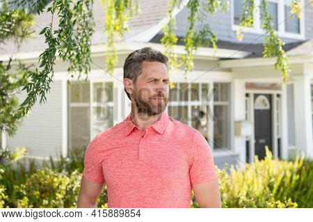 Man Standing In Front Of His New Home. Buy, Sell, Real Estate, Property, Home Insurance Concept. Rea