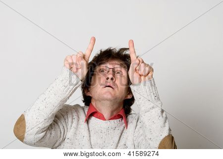 Man With Disheveled Hair Pointing Two Fingers At Something Interesting