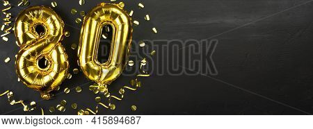 Golden Foil Balloon Number Eighty. Birthday Or Anniversary Card With The Inscription 80. Black Concr