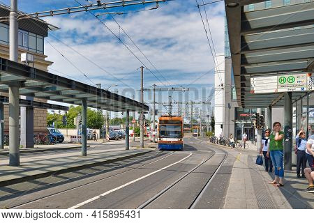 Mannheim, Germany - July 2019: People Waiting For Cable Car At Station In Front Of Mannheim Central