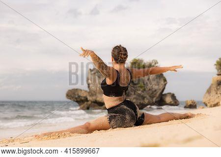 Yoga Practice. Flexible Caucasian Woman Practicing Hanumanasana, Monkey Pose Or Front Split. Hamstri