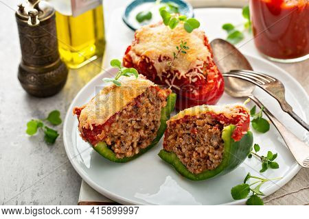 Stuffed Peppers With Ground Beef Filling On A Plate