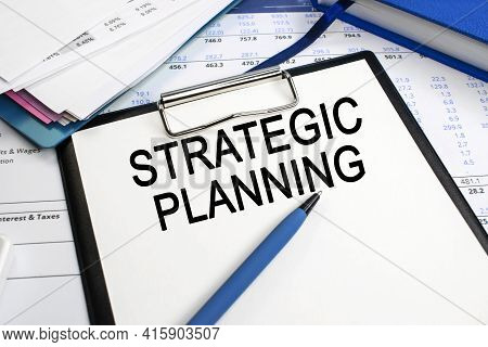 The Inscription Strategic Planning On A Stationery Tablet That Lies On The Document Near A Stack Of