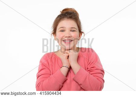 Emotional Teen Girl Keeps Hands Pressed Together, Hopes Dreams Come True, Makes Wish, Wears Pink Cas