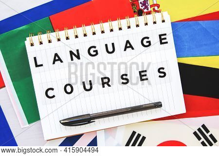 Copybook With The Inscription Foreign Language Courses On The Background Of The National Flags Of Di