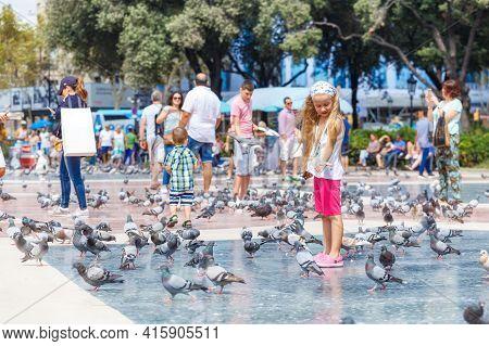 Barcelona, Spain - September 6, 2017 Real People On The Plaza De Catalunya.