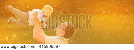Baby with his father on the background of the sunset in spring . Family playing on a walk in summertime. Kid is happy.