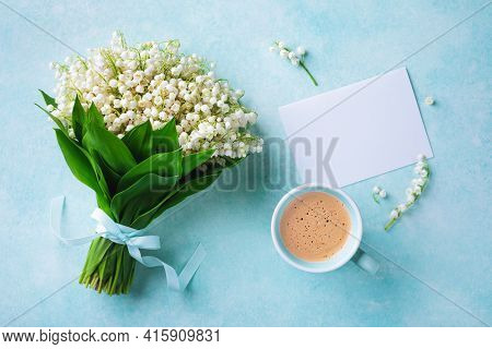 Coffee Cup With Spring Bouquet Of Flowers Lily Of The Valley And Empty Greeting Card Top View. Good