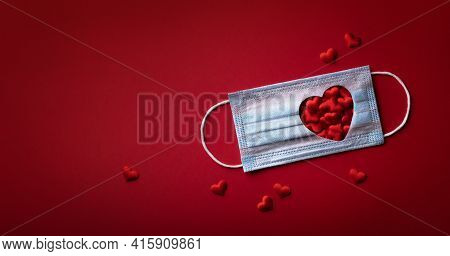 Medical Face Mask With Red Hearts Banner Top View. Disposable Surgical Mask As Symbol Of Coronavirus