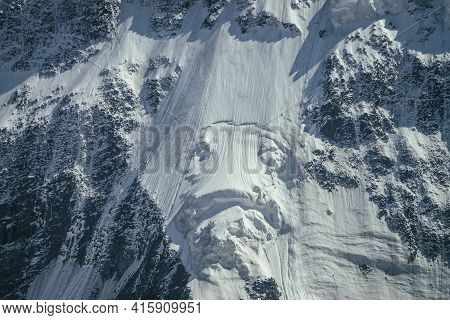 Nature Background Of Big Rocky Snowy Mountain Wall With White Glacier And Snow Cornice Close Up. Bea