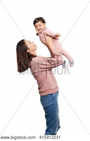 Portrait Of Pretty Caucasian Mother With Daughter Isolated On White Studio Background. Young Attract