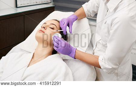 Beauty Injections Into A Beautiful Woman Face, Smoothing Of Mimic Wrinkles Around The Eyes Using Bio