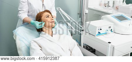 Adult Woman Getting Rejuvenation Skin Face With Ozone Therapy Procedure At Beauty Clinic Using Oxyge