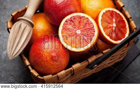 Sicilian Blood juicy oranges in basket and juicer