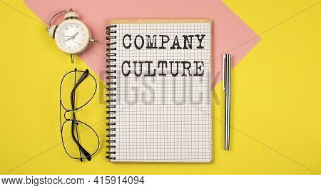 Company Culture On Notepad With Pen, Glasses And Alarm Clock