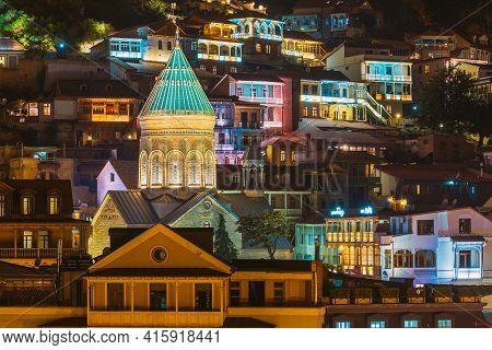 Tbilisi, Georgia. Saint George Armenian Cathedral Of Tbilisi. Church In Evening Or Night Illuminatio