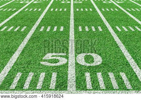 50 Yard Line Of American Football Field. View From With Sidelines